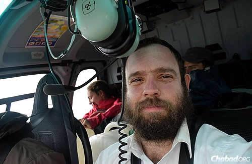 Rabbi Chezky Lifshitz—co-director of Chabad of Nepal with his wife, Chani—took to the skies himself in a Nepali government helicopter to reach the stranded. (Photos: Chabad.org/Nepal)