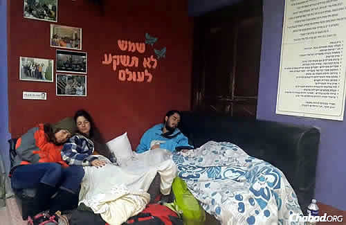 People make due at the Chabad House in Kathmandu, sleeping on couches, chairs, tables, mattresses on the floor—even outside on the ground.