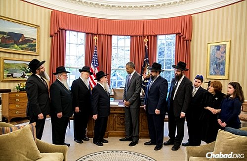 "President Barack Obama presents a ceremonial copy of the ""Education and Sharing Day, U.S.A."" proclamation that he issued on March 31, 2015 to a delegation of Chabad-Lubavitch emissaries and educators from around the country. (Official White House Photo: Pete Souza)"