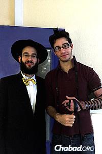 The rabbi with Sam Baderman, wrapping tefillin.