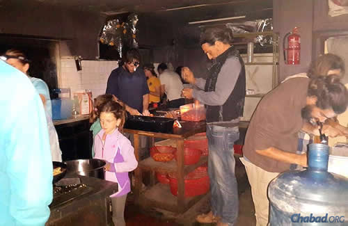 Making a meal out of scant items in the Chabad House kitchen. Food and water have been dwindling, though donations are coming into the country.