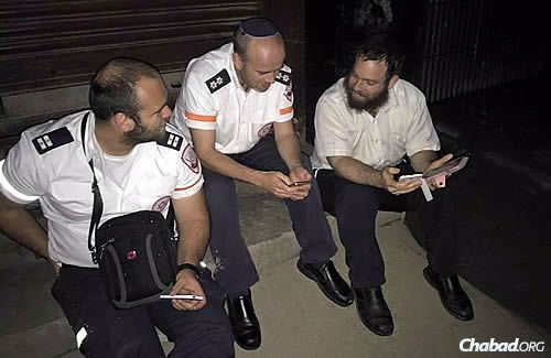 The rabbi with representatives of Magen David Adom—Israel's national emergency medical, disaster, ambulance and blood-bank service—who flew in from Israel to help.