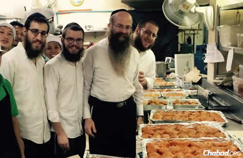 Rabbi Nechemya Wilhelm, third from left, with staff at the Chabad House in Bangkok, Thailand, which sees 100,000 visitors from around the world pass through its doors annually, offering Jewish tourists a place to relax, Internet accessibility, Shabbat meals and even aid in times of crisis.