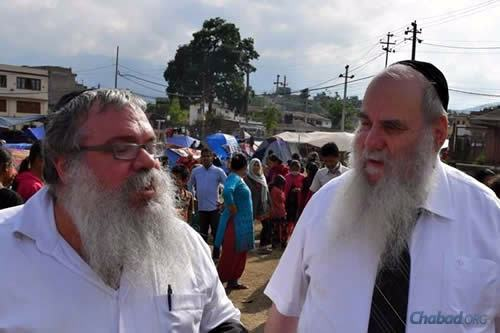 Rabbi Chaim Eliezer Ashkenazi, left, a Chabad-Lubavitch emissary in Thailand who coordinates many large-scale logistical Chabad operations in the Far East, with Rabbi Moshe Kotlarsky. They arrived in Nepal today, bringing some much-needed supplies. (Photo: Chabad.org/Nepal)