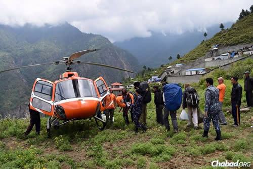 Rabbi Chezky Lifshitz has been flying via helicopter all over Nepal in search of both the living, who may still be stranded in far-flung places, and the dead, so their remains will be handled properly.