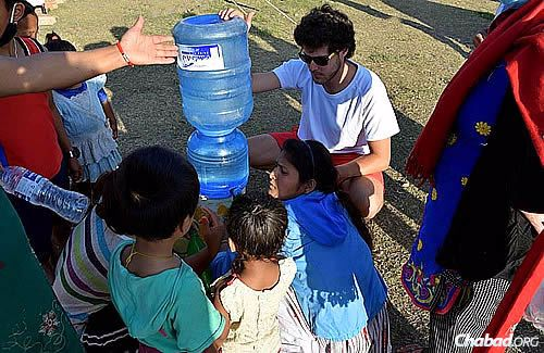 """""""The thirst is unbelievable,"""" says Chani Lifshitz. """"When we bring water, they literally fall upon us."""""""