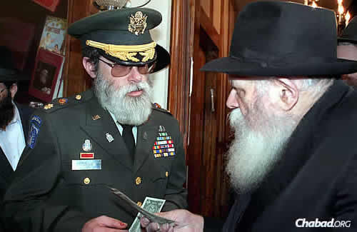 Getting a dollar from the Rebbe in December 1990, shortly before the first Gulf war. (JEM Photo)