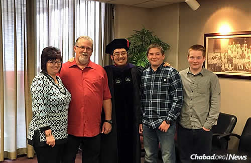 With family members, from left: stepmother Susan Hutchinson, father Daniel Hutchinson, and stepbrothers Ryan and Eric Schroeder