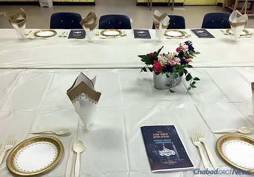 Prepping a proper table for Shabbat dinner.