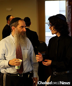 Dylan Thomas, a finalist in the Sinai Scholars Symposium, with Rabbi Menachem Schmidt, president of Chabad on Campus International. A senior at UC Berkeley, Thomas presented a research paper on the demographic challenges facing Israel. (Photo: Bentzi Sasson)