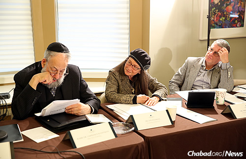 The judges panel: from left, Rabbi Dr. Lawrence Schiffman, Dr. Jan Feldman and Dr. Michael Carasik (Photo: Bentzi Sasson)