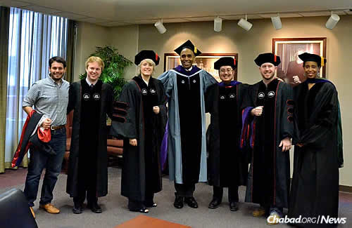 "Ari ""Brian"" Hutchinson had a separate graduation that took place the day before Shabbat. Here he is with, from left, Benjamin Cohen-Kurzrock, Chuck Hooten, LaDelle Davenport, University of Houston Law Center dean Leonard M. Baynes, Hutchinson, Michael Ryan and associate dean of student affairs Sondra Tennessee."