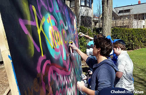 Group activities are also par for the course. Here, a little spray paint and a board …