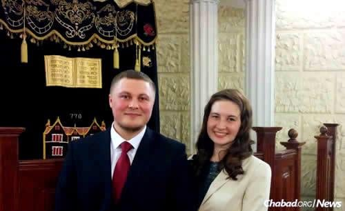 Yosef, from a city 1,000 kilometers away from Tyumen, stands with his bride Sarah in her hometown synagogue in Chelyabinsk. The two met on the trip and are engaged to be married. (Photo: Eli Itkin)