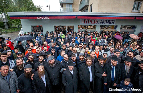 The group stands outside the Hyper Cacher market, which was the site of a terror attack in January that left four Jewish men dead. Rabbi Berel Lazar, Russia's chief rabbi and head Chabad-Lubavitch emissary, is in the front, second from right; to his left is Rabbi Mendy Wilansky, youth director of the Federation of Jewish Communities of Russia. (Photo: Eli Itkin)