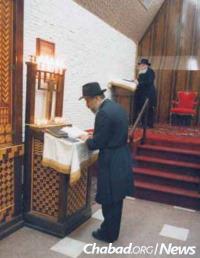 Leading communal prayers at 770 Eastern Parkway in the Crown Heights neighborhood of Brooklyn, N.Y., near the Rebbe—Rabbi Menachem M. Schneerson, of righteous memory.