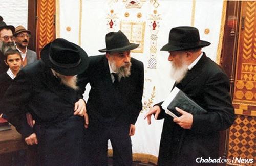 Rabbi Klein, center, joined the Rebbe's secretariat as an aide to Rabbi Chaim Mordechai Aizik Hodakov, left, the Rebbe's chief of staff.