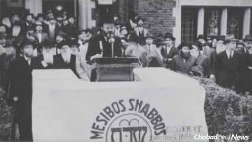 Rabbi Klein is in the background, center right, at an early Mesibos Shabbos rally.