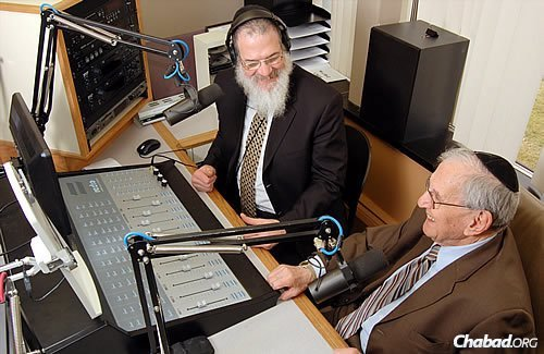 """Rabbi Herschel Finman, left, host of the """"Jewish Hour"""" Sunday radio show on Detroit's Channel WLQV-AM 1500, interviews """"Specs Howard"""" (Jerry Liebman) as part of its """"chai"""" (18 year) anniversary program. The radio pioneer had been Finman's first interview more than 19 years ago when the show started."""