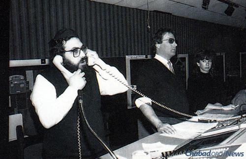 Rabbi Hillel Dovid Krinsky, JEM's founder, working the phones during a broadcast. (JEM Photo)