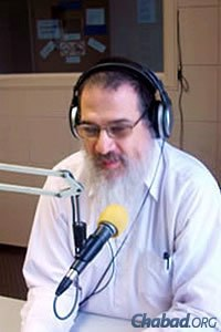 The rabbi works hard to blend information, inspiration and music into every program.
