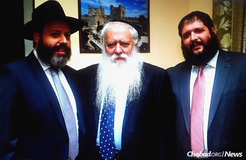 Vagner with sons Rabbi Aharon Vagner and Rabbi Binyamin Vagner, both Chabad-Lubavitch emissaries in Russia