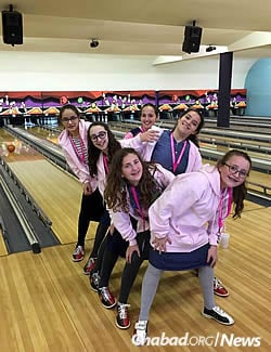 Before the mental tests, the girls enjoy a little physical activity at the bowling alley.