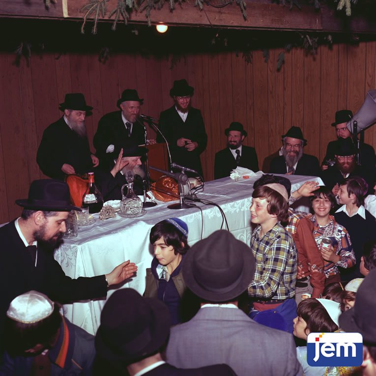"""Ushering """"Released Time"""" students past the Rebbe, at a special Sukkot rally on 19 Tishrei, 5737."""