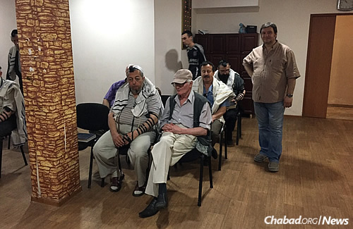 "Congregants in the synagogue. Gopin says ""people were also happy to see me because if I was able to return, even if just for a short visit, it already means things are getting a little better."""