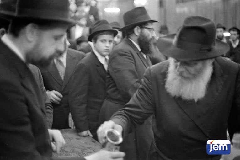 Receiving wine from the Rebbe's cup following Simchat Torah, 5737.