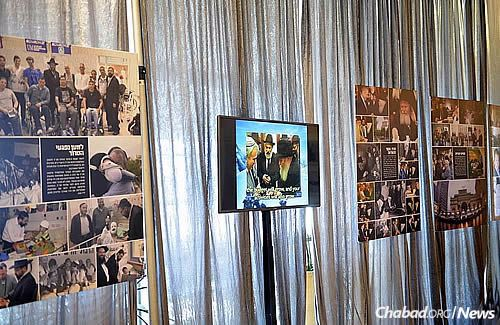A specially curated gallery of photos of the Rebbe and Chabad's activities all over the world line the halls of the Knesset building. (Photo: Meir Alfasi)