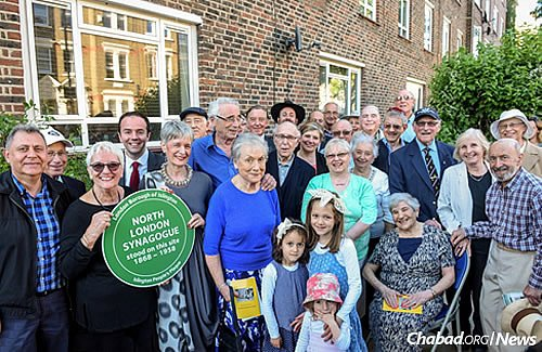 Some of the nearly 100 people who attended the June 4 ceremony unveiling the plaque.