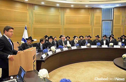 MK Ofir Akinus (Likud) addresses those assembled in the Knesset. (Photo: Meir Alfasi)