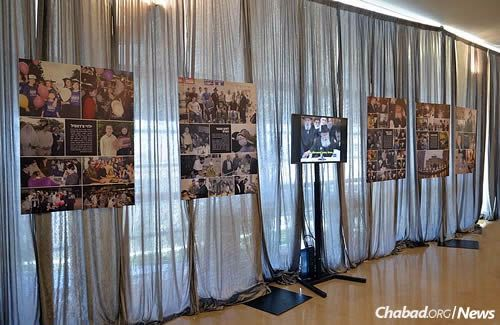 The images and inspirational texts are displayed alongside a multimedia presentation of the Rebbe's leadership and messages of empowerment. (Photo: Meir Alfasi)