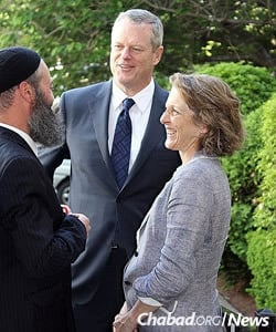 Rabbi Yossi Lipsker, co-director of Chabad of the North Shore with his wife, Layah, greets the Bakers as they arrive at the event venue.