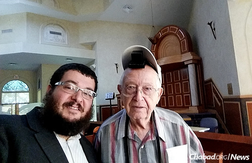 Rabbi Levi Chanowitz, director of development at Synagogue of Inverrary–Chabad in South Florida, with congregant Michael Kahan.
