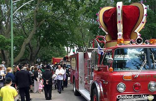 The parade was led by a special retrofitted firetruck, complete with a crown to mark the occasion.