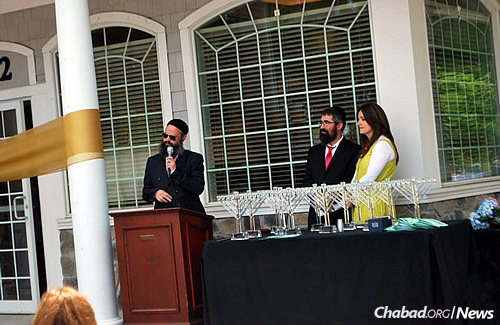 Lipsker at the grand opening of Chabad of Peabody Jewish Center, led by Rabbi Nechemia and Raizal Schusterman, above, which was celebrated the same day as the gala dinner.