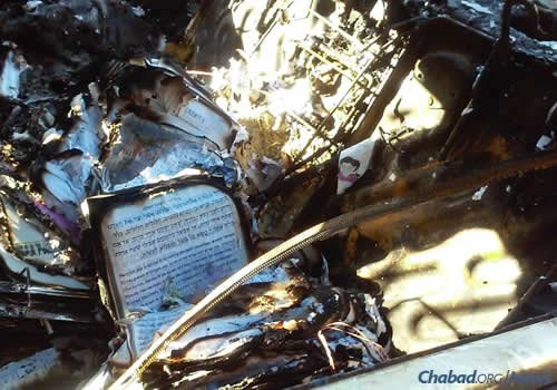 Among the objects burned in the arson fire that destroyed the car of Rabbi Sholom Ber and Rochela Rodal were prayerbooks, tefillin and mezuzahs. (Photo: Chabad of Mt. Olympus)