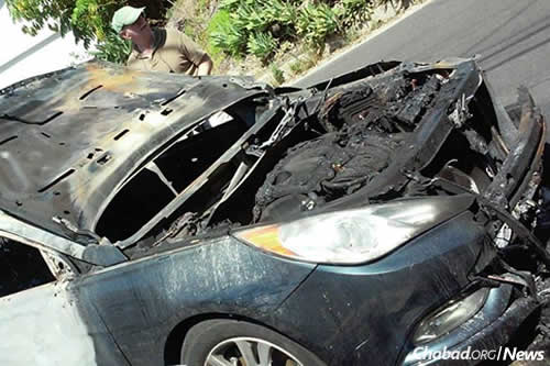 The car was totally destroyed by the intentional fire. No arrests have yet been made. (Photo: Chabad of Mt. Olympus)