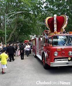The parade was led by a retro-fitted firetruck, complete with a crown to mark the occasion.