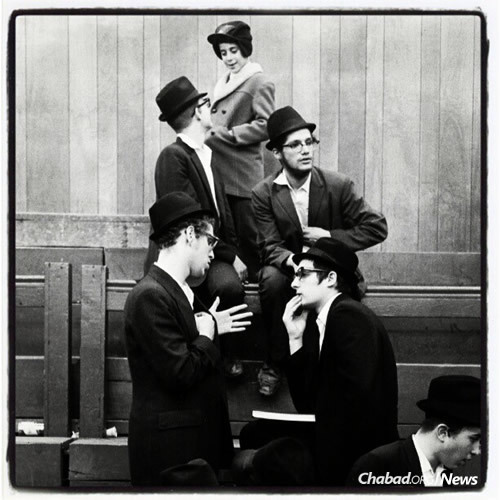 Yeshivah students in discussion at 770 Eastern Parkway, circa 1970. (Photo: Leonard Freed)