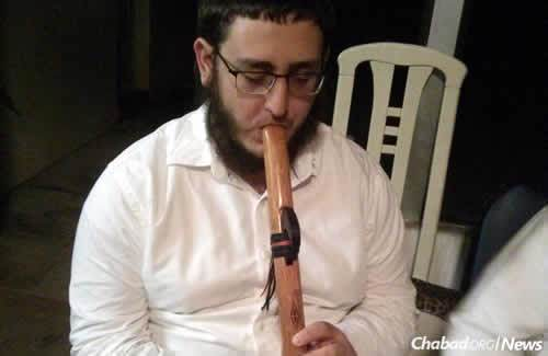 Lew taught himself to play the Native American flute, a hand-crafted wooden instrument he sometimes shares at events.