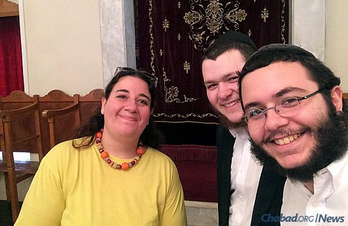 """The """"Roving Rabbis"""" with a local resident in the synagogue of Larissa, which serves a community that has been in place for more than 2,000 years."""