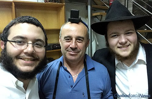 Even in uncertain times, Larissa small-business owners gladly took time out to wrap tefillin and pray.