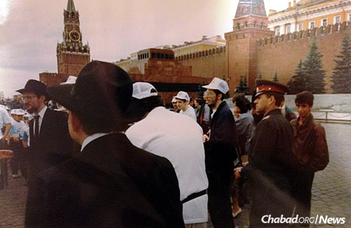 Camp Gan Israel Moscow at Red Square, with Chief Rabbi of Russia Berel Lazar standing on the far left as a policeman looks on.