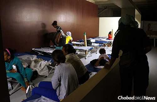 Women in their sleeping quarters; many will remain for just one night before boarding the trains above to where they hope to be greeted by family and friends in Northern Europe.