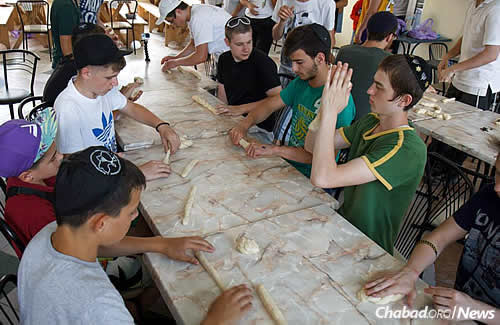 Activities at Camp Yeka include swimming, sports and Jewish classes—and making challah, too, even for the older boys.