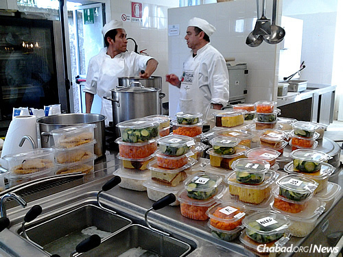 Meals are being provided in Italy to Eritrian, Ethiopian, Sudanese and Syrian refugees, many of them Muslim, who temporarily stay in rooms below the Milan central train station, these days retrofitted as a Holocaust memorial and museum.