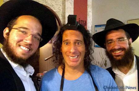 Helping a Jewish man in Peru put on tefillin.